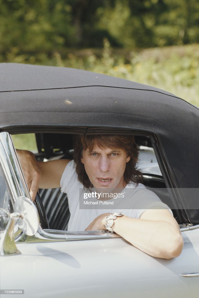 English guitarist Jeff Beck at the wheel of his Chevrolet Corvette at his home, UK, 1984.