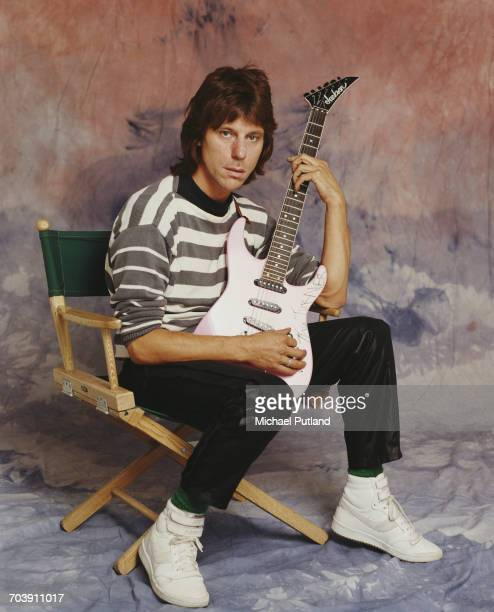 English guitarist Jeff Beck, London, October 1984. He is holding a guitar with the name 'Tina Turner' written on the body, possibly an autograph.