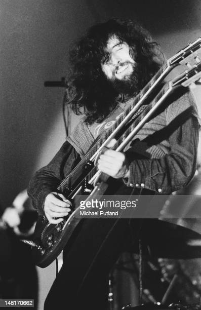 English guitarist Jimmy Page playing a doubleneck guitar on stage with Led Zeppelin at the Empire Pool Wembley London 23rd November 1971