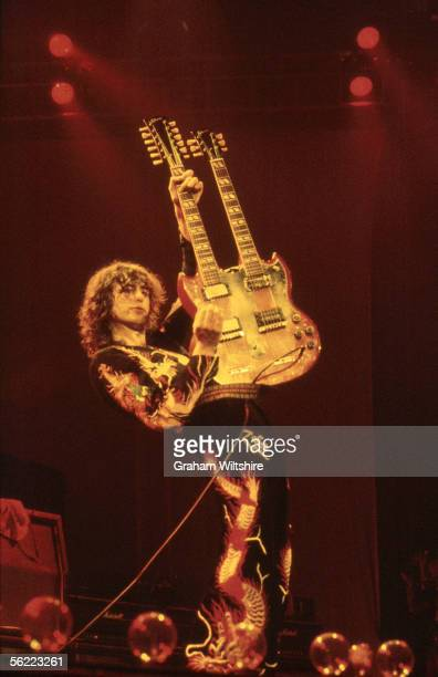 English guitarist Jimmy Page playing a doublenecked six and twelve stringed guitar during a Led Zeppelin concert at Earl's Court London 18th May 1975