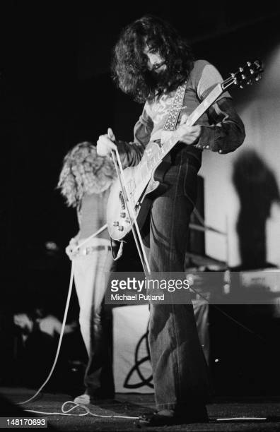 English guitarist Jimmy Page using a violin bow on his guitar during a performance with Led Zeppelin at the Empire Pool Wembley London 23rd November...