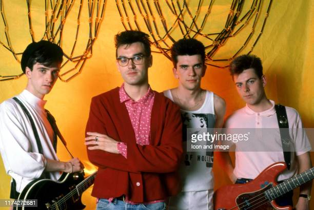 English guitarist Johnny Marr English singer Morrissey English drummer Mike Joyce and English bassist Andy Rourke of The Smiths pose for a portrait...