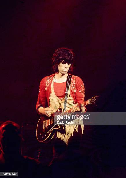 English guitarist Keith Richards of The Rolling Stones performs live on stage playing a Gibson Les Paul Custom guitar at Colston Hall in Bristol...