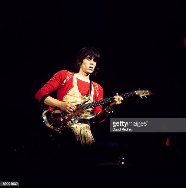 English guitarist Keith Richards of The Rolling Stones performs live on stage playing an Ampeg Dan Armstrong perspex guitar at Colston Hall in...