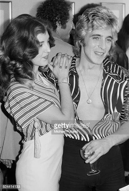 English guitarist Mick Ronson of English rock group Mott the Hoople with his future wife Suzi Fussey London 19th September 1974