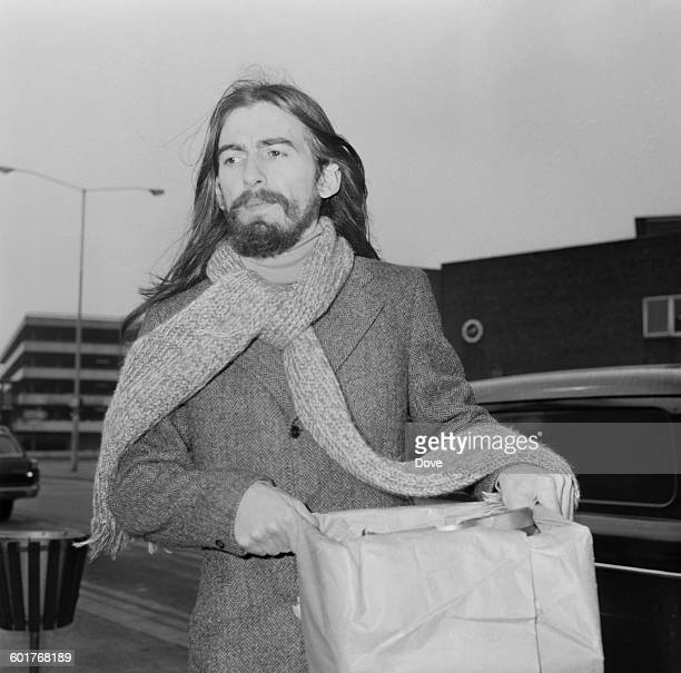 English guitarist, singer and songwriter George Harrison of the Beatles at London Airport, UK, 14th March 1970.