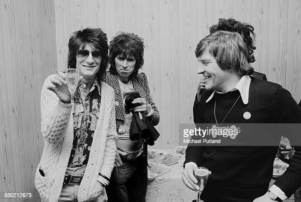 English guitarists Ron Wood of rock group Faces and Keith Richards of the Rolling Stones at a reception for producer Phil Spector 4th October 1974