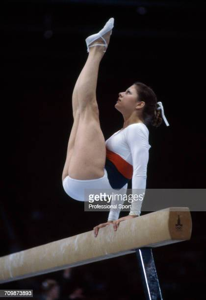 English gymnast Suzanne Dando pictured in action for the Great Britain team on the balance beam during competition in the women's artistic team...