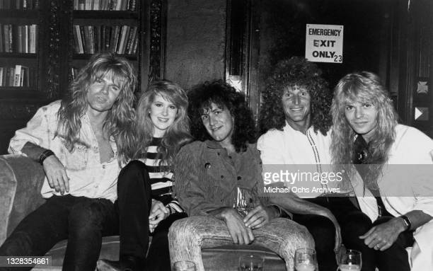 English hard rock band Whitesnake pose with MTV VJ China Slick at the Limelight in New York City after a performance at Madison Square Garden, circa...
