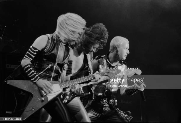 English heavy metal band Judas Priest performing live at the Hammersmith Odeon, London, UK, 16th December 1983; KK Downing, Glenn Tipton, and Rob...