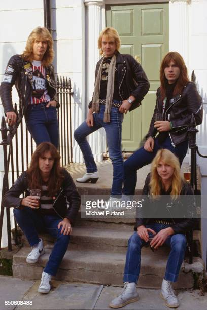 English heavy metal group Iron Maiden in Islington London 1982 Back row left to right drummer Clive Burr guitarist Adrian Smith and singer Bruce...