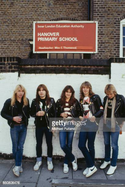 English heavy metal group Iron Maiden outside Hanover Primary School in Islington London 1982 Left to right guitarist Dave Murray singer Bruce...