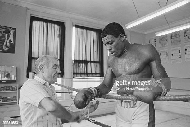 English heavyweight boxer Frank Bruno pictured during a training session with his trainer and manager Terry Lawless at Terry Lawless' gym in London...