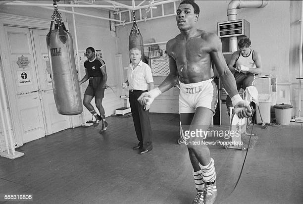 English heavyweight boxer Frank Bruno pictured during a training session under the watchful eye of his trainer and manager Terry Lawless at Terry...