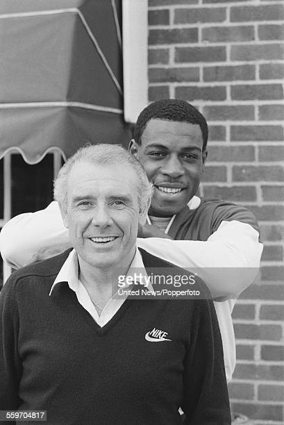 English heavyweight boxer Frank Bruno pictured with his manager and trainer Terry Lawless in London on 2nd March 1984