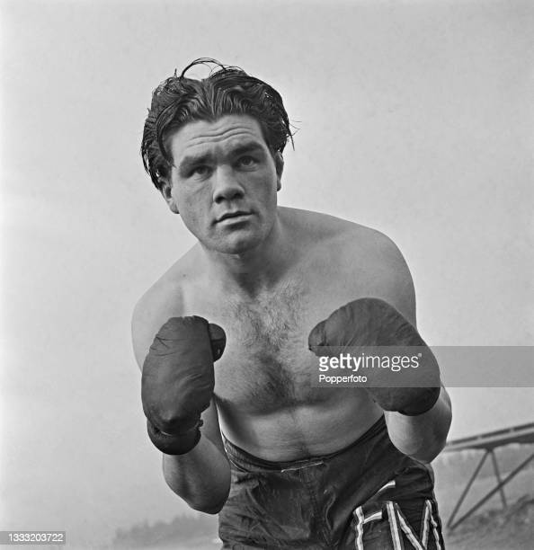 English heavyweight boxer Freddie Mills , a sergeant in the Royal Air Force, trains at a RAF facility in England during World War II on 17th November...