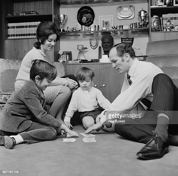 English heavyweight boxer Henry Cooper at home with his wife Albina Genepri and their sons Henry Marco and John Pietro UK 17th April 1971