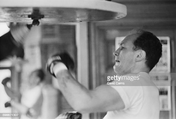 English heavyweight boxer Henry Cooper training at the Thomas a Becket gymnasium on the Old Kent Road for his upcoming fight with Billy Walker London...