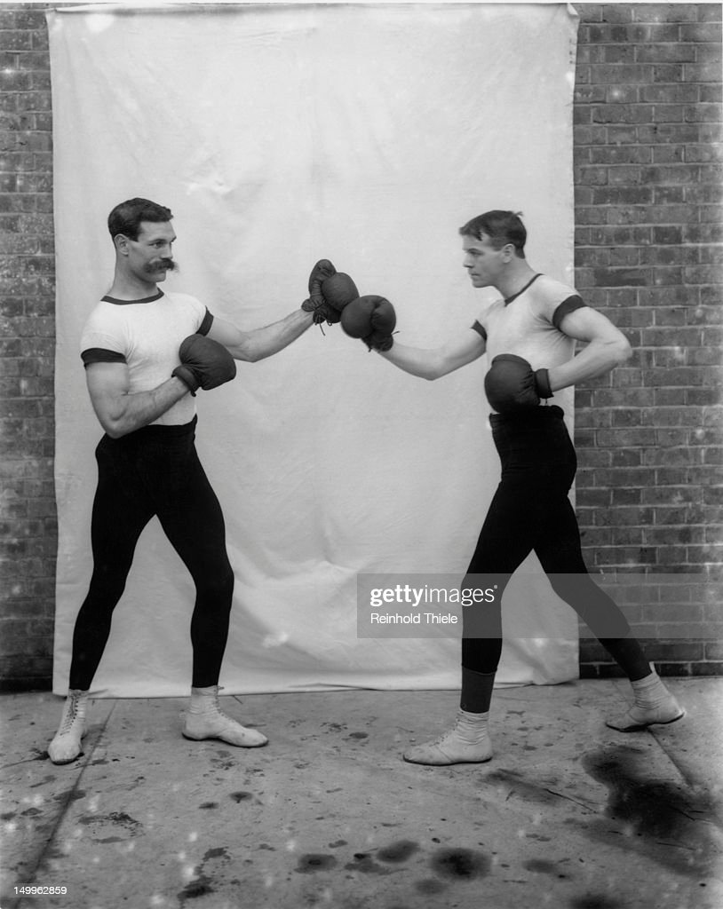 English heavyweight boxers Gunner Hewitt (1879 - 1917, left) and Jim Maher pose in the upright stance, circa 1910.