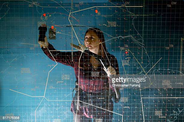 English Heritage site manager Rachael Bowers spring cleans the giant nuclear fallout map at the York Cold War Bunker on February 12 2016 in York...