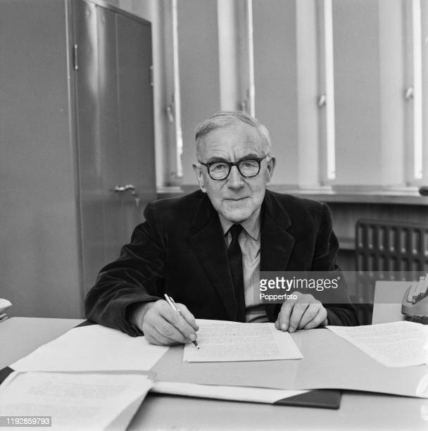 English historian A J P Taylor seated at a desk in July 1967