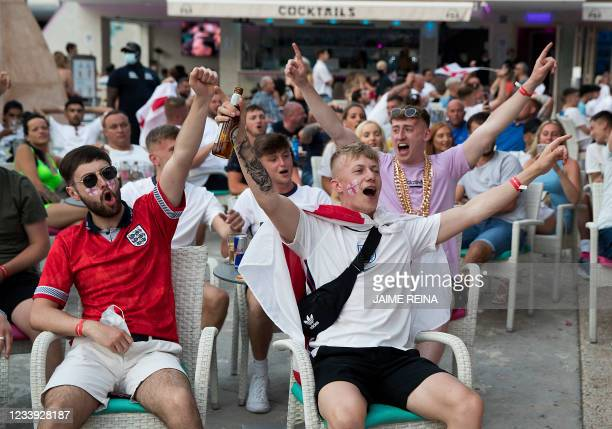English holidaymakers react as they watch the UEFA EURO 2020 final football match between Italy and England at a bar of Magaluf in Calvia on the...
