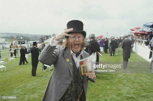 English horse racing journalist and pundit John McCririck pictured in top hat and formal dress as he attends the 1993 Epsom Derby horse race meeting...