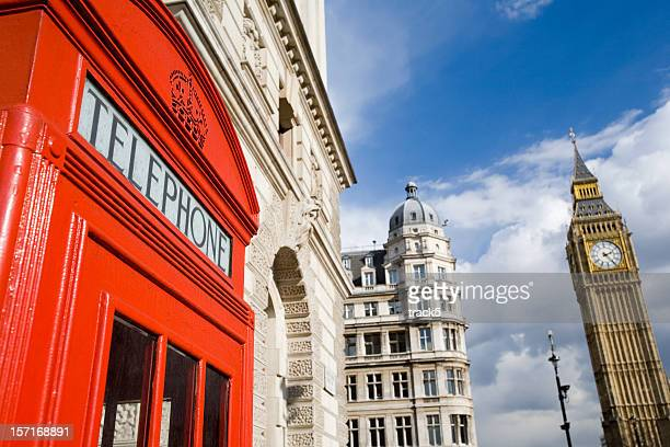 english icons: big ben and a traditional red telephone box - whitehall london stock photos and pictures
