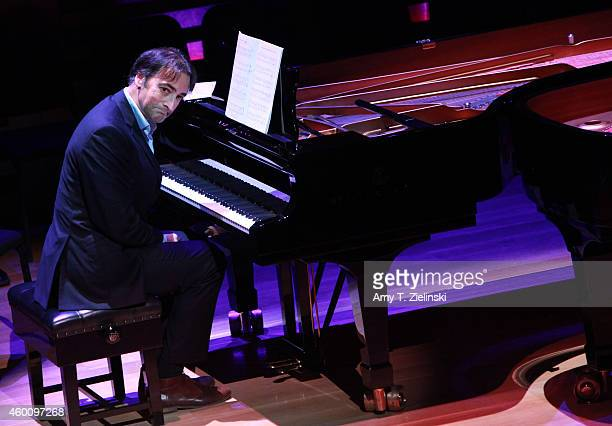 English impressionist Alistair McGowan plays at a Steinway piano during a performance of 'Word And Play Celebrity Christmas Gala' at Kings Place on...