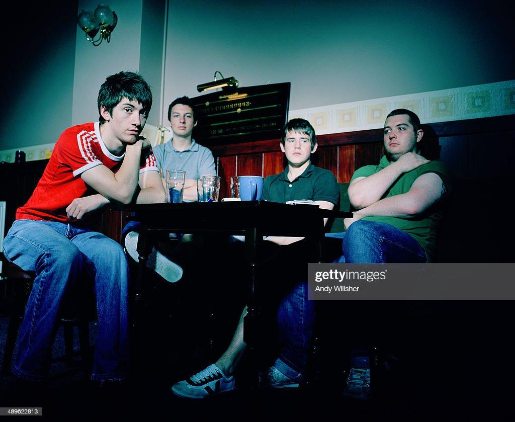 English indie rock band Arctic Monkeys in a pub, 2006. Left to right: singer Alex Turner, drummer Matt Helders, guitarist Jamie Cook and bassist Andy Nicholson.