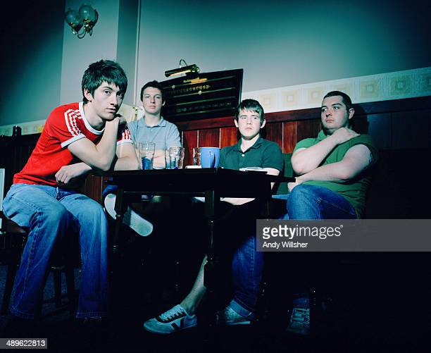 English indie rock band Arctic Monkeys in a pub 2006 Left to right singer Alex Turner drummer Matt Helders guitarist Jamie Cook and bassist Andy...