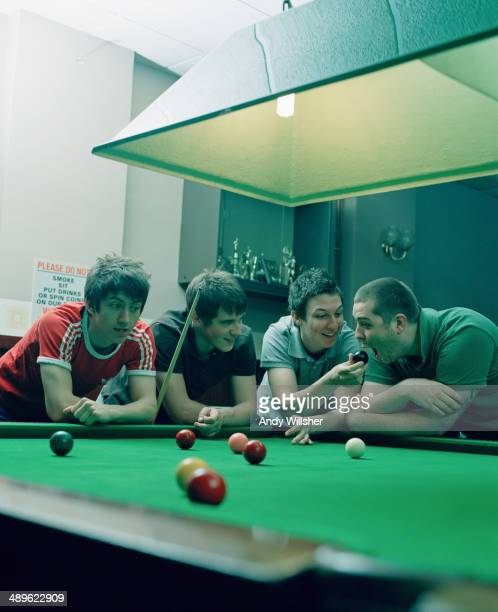 English indie rock band Arctic Monkeys in a snooker hall 2006 Left to right singer Alex Turner guitarist Jamie Cook drummer Matt Helders and bassist...