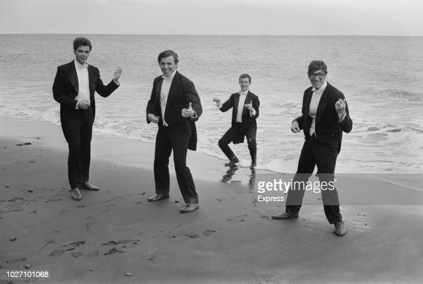 English instrumental group The Shadows pictured together on a beach in the Canary Islands, Spain during filming of the film musical Wonderful Life...