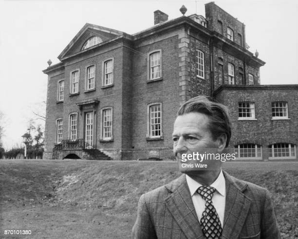 English interior designer David Nightingale Hicks outside his home Britwell House in Oxfordshire March 1979 He and his wife Pamela Hicks are selling...