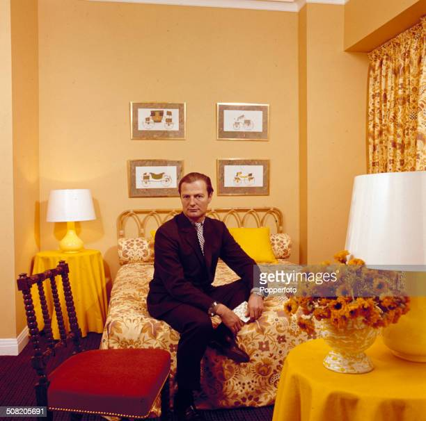 English interior designer David Nightingale Hicks posed on a bed in his basement flat in 1966