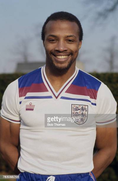 English international professional footballer Cyrille Regis of West Bromwich Albion posed wearing an England national football team shirt circa 1982