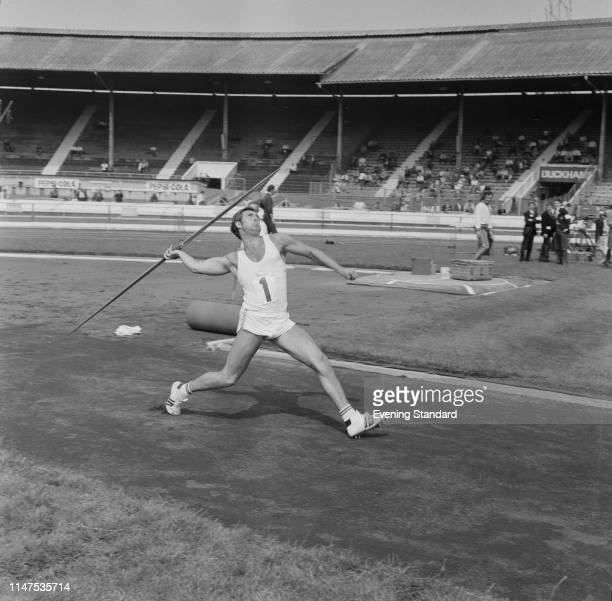 English javelin thrower Dave Travis in action during an event, UK, 27th August 1969.