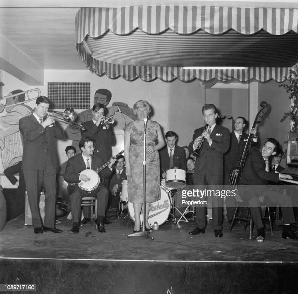 English jazz clarinet player Monty Sunshine pictured 3rd from right as he performs live on stage with the Monty Sunshine Jazz Band at a jazz club in...