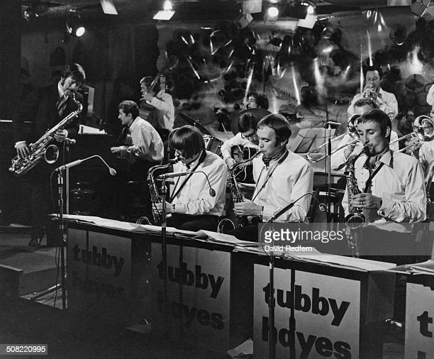 """English jazz multi-instrumentalist, Edward Brian """"Tubby"""" Hayes performs with his band at 'Ronnie Scott's' jazz club, London, England, circa 1970."""