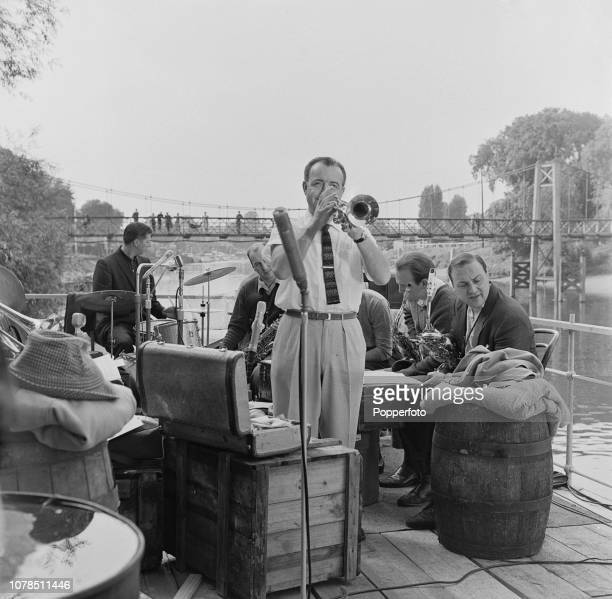 English jazz musician and trumpet player Kenny Baker performs with his band on ABC Television's 'Steamboat Shuffle' television series set on a...
