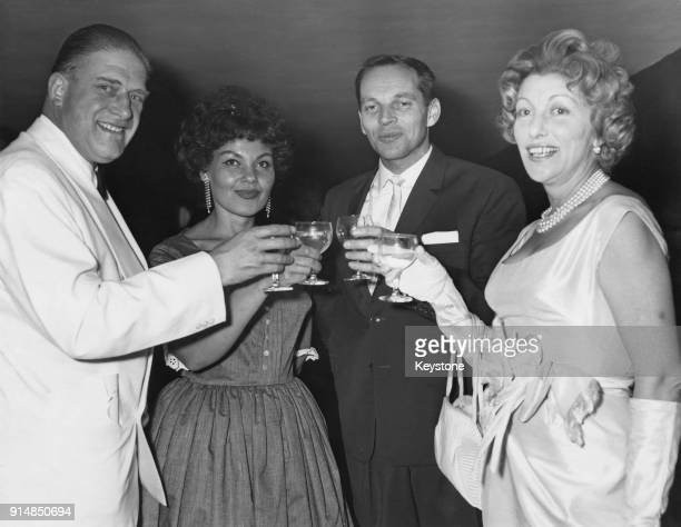 English jazz musician Johnny Dankworth and his wife singer Cleo Laine with the Honourable Gerald Lascelles and his wife Angela at a reception held...