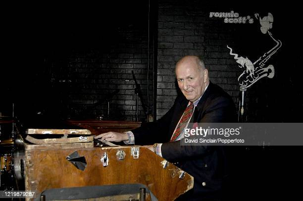 English jazz organist and pianist Mike Carr performs live on stage at Ronnie Scott's Jazz Club in Soho, London on 5th December 2005.