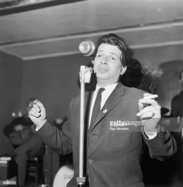 English jazz singer and writer George Melly singing with the Mick Mulligan jazz band in a London nightclub April 1960