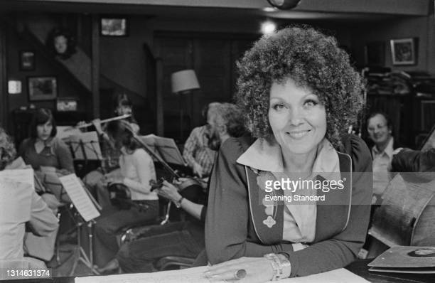 English jazz singer Cleo Laine with a group of musicians, UK, 1st June 1974.