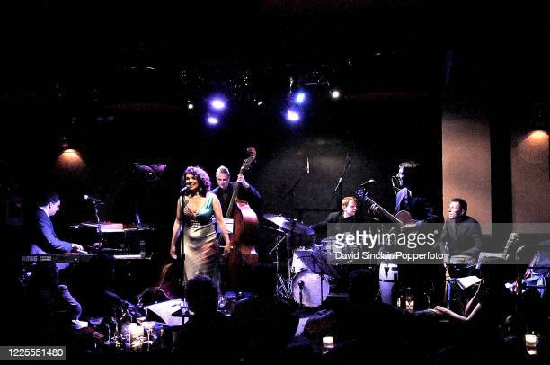 English jazz singer Jacqui Dankworth performs live on stage with her band at Ronnie Scott's Jazz Club in Soho London on 14th April 2008