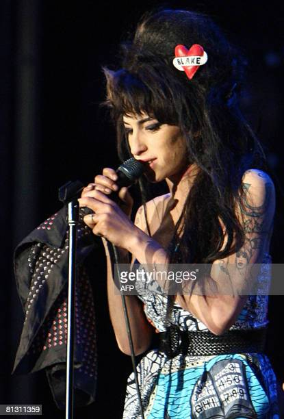 English jazz soul singer Amy Winehouse performs on stage during the Rock in Rio Lisboa music festival at the Bela Vista Park in Lisbon on May 30 2008...