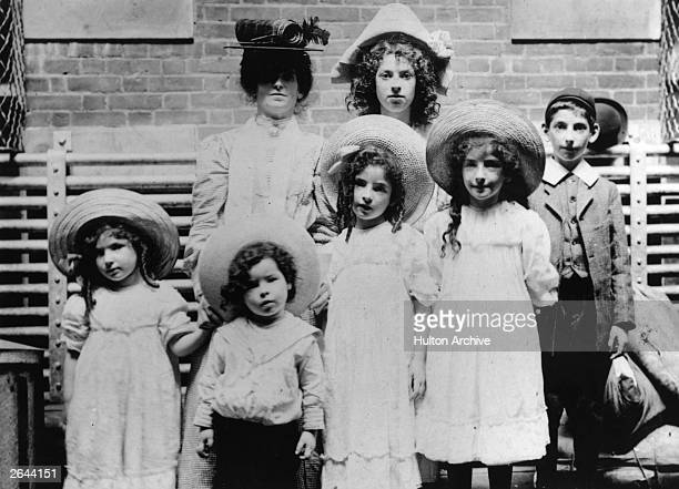English Jewish immigrants await inspection at Ellis Island, New York, before entering the United States.