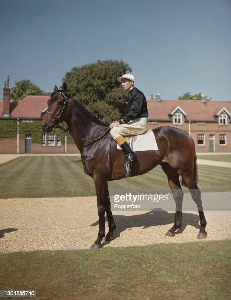 English jockey Harry Wragg on the racehorse Gulf Stream at stables in England on 9th May 1946. Harry Wragg would retire as a jockey at the end of the...