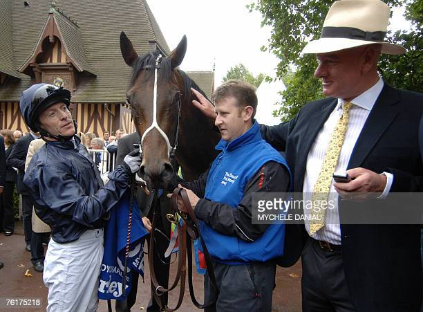 English Jockey Kieren Fallon takes care of his horse Myboycharlie flanked by his owner M.Magnier after winning the Darley Morny price, 19 August 2007...