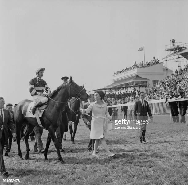 English jockey Lester Piggott on top of Americanbred Irishtrained Thoroughbred racehorse Sir Ivor led by Princess Caroline Murat after winning the...